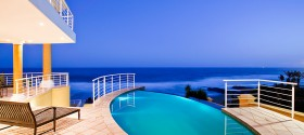 Views over a pool towards the ocean are always most effective as different blue hues are experienced in the shot.